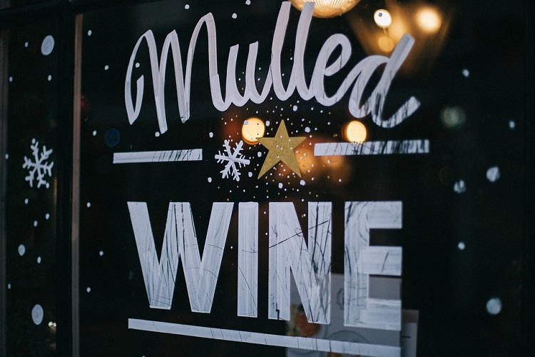 A window graphic depicting a mulled wine advertisement